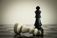Chess Success. Checkmate black chess defeats white king on the chess board Stock Photography