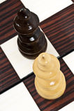 Chess table. Queen and king closeup on chessboard Royalty Free Stock Image