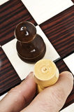 Chess table. Rook and pawn closeup on chessboard Royalty Free Stock Photo