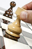 Chess table. Rook and pawn closeup on chessboard Stock Photos