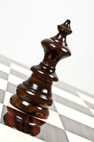 Chess table. Black queen closeup on chessboard Royalty Free Stock Image