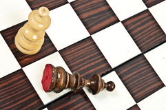 Chess table. White Queen defeat black king closeup on chessboard Stock Photo