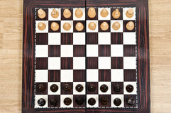 Chess table. Chess pieces arrangement closeup on chessboard Stock Images