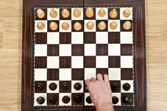 Chess table. Chess pieces arrangement closeup on chessboard Royalty Free Stock Photo
