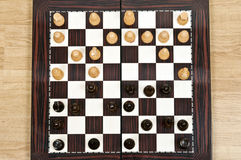 Chess table. Chess pieces during game closeup on chessboard Stock Photo