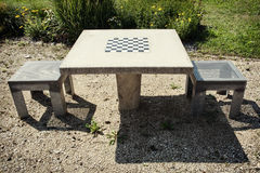 Chess table and chairs Royalty Free Stock Photo