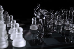 Chess table and figures of glass Royalty Free Stock Photos