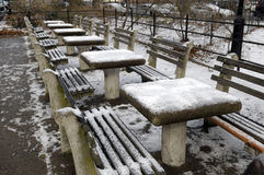 Chess tables with snow. Chess tables outside in the park covered with snow Royalty Free Stock Photo