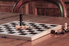 Chess tactics concept with chess game and pawns on vintage table. Stock Photos