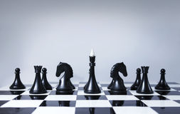 Chess team. Black chess team on the chessboard Stock Image