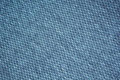 Chess texture fluffy cloth. Dark blue background. Royalty Free Stock Photo