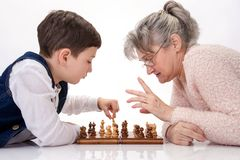 Chess between two generations Stock Photo