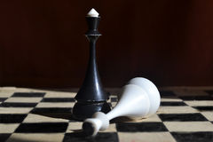 Chess. Two king chess pieces on a chess board Stock Image