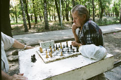 Chess in Ukrainian. DNIPROPETROVSK, UKRAINE – CIRCA JULY 2010: Ukrainians are playing chess in one of the city parks circa July 2010 in Dnipropetrovsk Stock Image