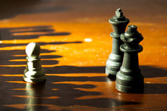 Chess. Using the light to create the impression of many troops Royalty Free Stock Photos