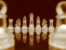 Chess V. Chessmen in a row in bright sepia Royalty Free Stock Photos
