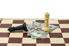 Chess victory and money Stock Photos