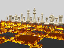 Chess war 1. White chess pieces, board burns with a bright flame. On a gray background Stock Photos