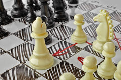 Chess. The white Bishop is under attack. White board with chess figures on it. Plan of battle Stock Photos