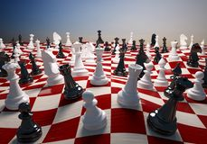 Chess white and black on the waving chess field. Chess white and black on the big waving chess field Royalty Free Stock Photos