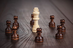 Chess win concept over wooden background. Chess winning concept on the wooden background Royalty Free Stock Photo