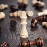 Chess win concept over wooden background Royalty Free Stock Images