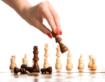 Chess and woman hand Royalty Free Stock Photos