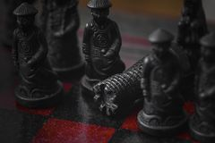 Chess with wonderful old chinese figures royalty free stock photo