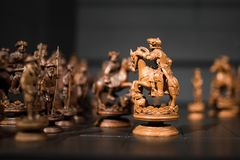Chess with wonderful old wooden figures royalty free stock photo