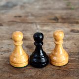 Chess on wood. Chess on the wooden background Stock Image