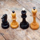 Chess on wood. Chess on the wooden background Stock Photos