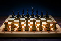 Chess on a wooden board Royalty Free Stock Image