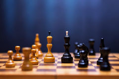 Chess on a wooden board Stock Photography