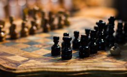 Chess on wooden chessboard Royalty Free Stock Photo