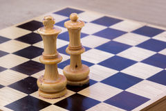Chess. Wooden old chessboard  with some chess pieces Stock Photo