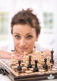 Chess1. Young businesswoman playing chess, woman in background royalty free stock photo