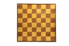 Chessboard. Old and aged wooden chessboard on a white background Royalty Free Stock Photo