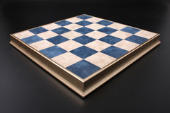 Chessboard on a black background. field in the cell Royalty Free Stock Photo