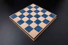 Chessboard on a black background. field in the cell Stock Images