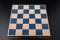 Chessboard on a black background. field in the cell Royalty Free Stock Images