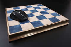 Chessboard on a black background. field in the cell Stock Photos