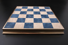 Chessboard on a black background. field in the cell Stock Image