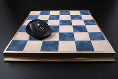 Chessboard on a black background. field in the cell Royalty Free Stock Image