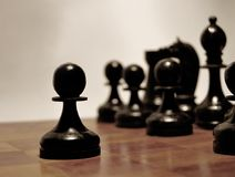 Chessboard, black pawn. Makes its first move Royalty Free Stock Images