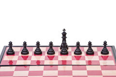 Chessboard with black pawns and king Stock Photography