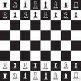 Chessboard with black and white chess pieces Royalty Free Stock Images