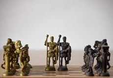 Chessboard with brass coins denoting leadership,business strategy,unity in diversity. royalty free stock images