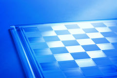 Chessboard Or Checkerboard Background. A chessboard or checkerboard background with a blue tone and no pieces Stock Photo
