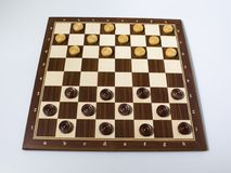 Chessboard checkers game in a white background. Composition stock photography