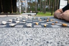 Chessboard for chess or outdoor checkers in the park royalty free stock photo